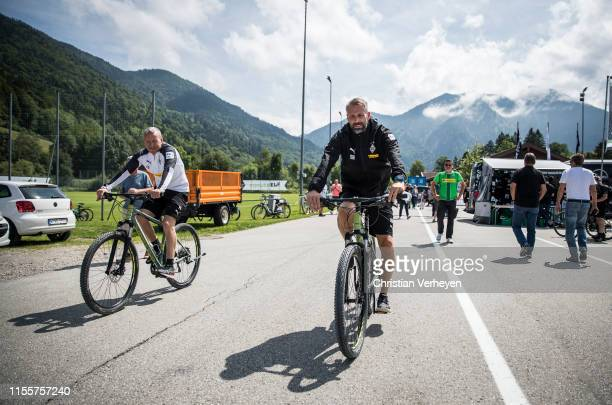 Assistant Coach Frank Geideck and Head Coach Marco Rose go by bike during the Borussia Moenchengladbach Training Camp on July 15, 2019 in...