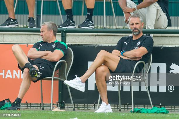 Assistant coach Frank Geideck of Borussia Moenchengladbach and head coach Marco Rose of Borussia Moenchengladbach looks on during the pre-season...