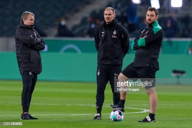 Assistant coach Frank Geideck of Borussia Moenchengladbach, assistant coach Alexander Zickler of Borussia Moenchengladbach and assistant coach Rene...