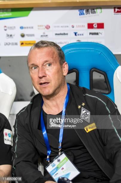 Assistant Coach Frank Geideck of Borussia Moenchengladbach is seen during a friendly match between Guangzhou R&F and Borussia Moenchengladbach as...