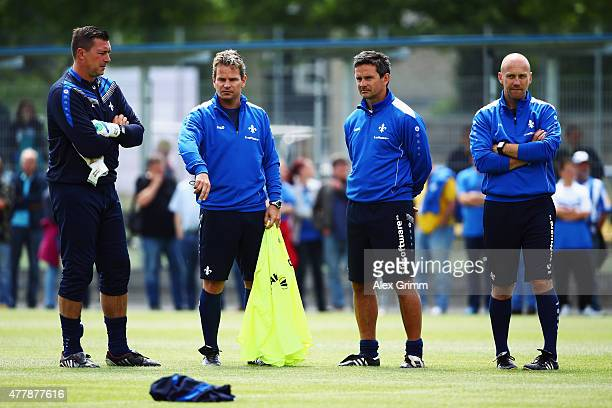 Assistant coach Frank Steinmetz head coach Dirk Schuster assistant coach Sascha Franz and goalkeeper coach Dimo Wache look on during the first...