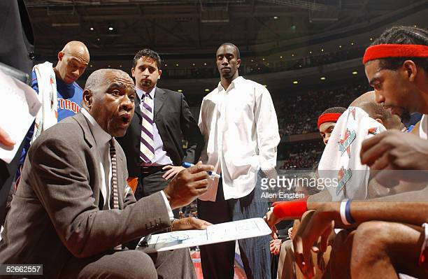 Assistant coach Garfield Heard of the Detroit Pistons instructs his team during a timeout against the Dallas Mavericks during the game at The Palace...