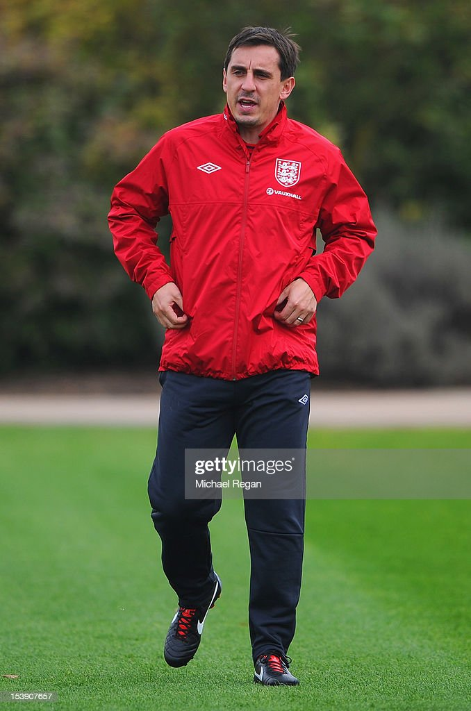 Assistant coach Gary Neville looks on during the England training session ahead of their FIFA World Cup qualifier against San Marino at London Colney on October 11, 2012 in St Albans, England.