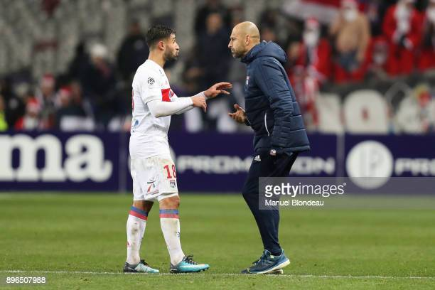 Assistant coach Gerald Baticle of Lyon talks to Nabil Fekir during the Ligue 1 match between Toulouse and Olympique Lyonnais at Stadium Municipal on...