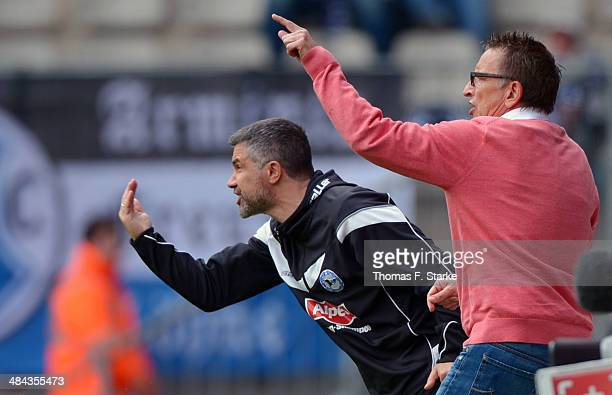 Assistant coach Gino Lettieri and head coach Norbert Meier of Bielefeld react during the Second Bundesliga match between Arminia Bielefeld and...