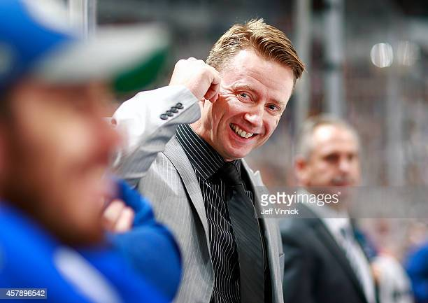 Assistant coach Glen Gulutzan of the Vancouver Canucks looks on from the bench during their NHL game against theTampa Bay Lightning at Rogers Arena...