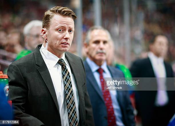 Assistant coach Glen Gulutzan of the Vancouver Canucks looks on from the bench during their NHL game against the Minnesota Wild at Rogers Arena...