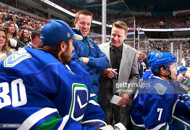 Assistant coach Glen Gulutzan of the Vancouver Canucks talks to Ryan Miller during their NHL game against theTampa Bay Lightning at Rogers Arena...