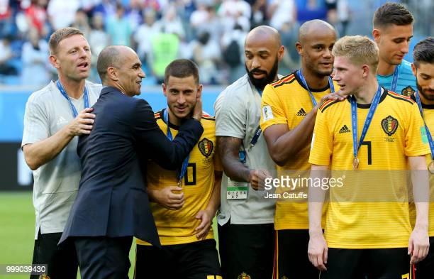 Assistant coach Graeme Jones, coach of Belgium Roberto Martinez greeting Eden Hazard, assistant coach Thierry Henry, Vincent Kompany, Kevin De Bruyne...
