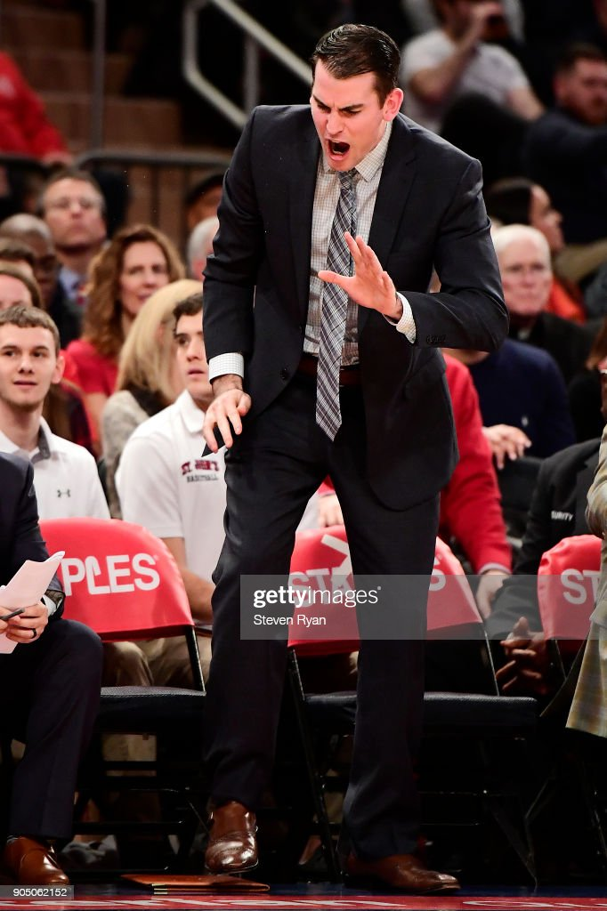 Assistant coach Greg St. Jean of the St. John's Red Storm reacts against the Villanova Wildcats during an NCAA men's basketball game at Madison Square Garden on January 13, 2018 in New York City.