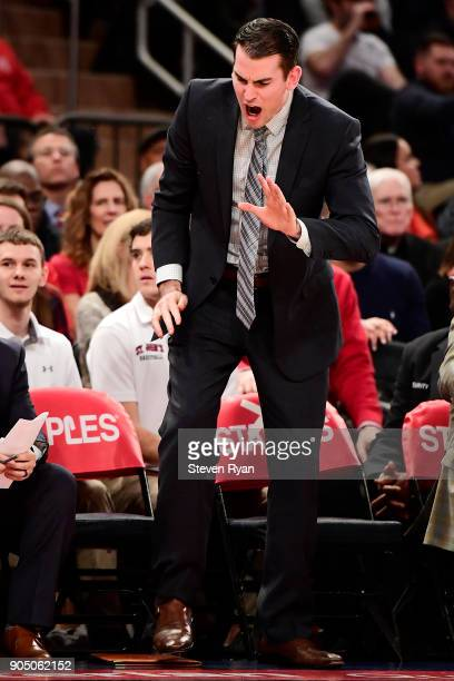 Assistant coach Greg St Jean of the St John's Red Storm reacts against the Villanova Wildcats during an NCAA men's basketball game at Madison Square...