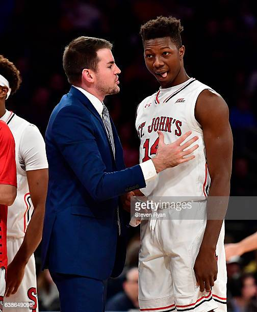 Assistant coach Greg St Jean speaks with Kassoum Yakwe of the St JohnÕs Red Storm against the Villanova Wildcats at Madison Square Garden on January...