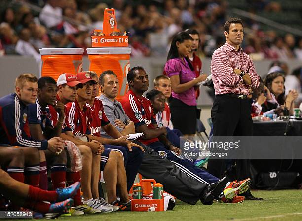 Assistant Coach Greg Vanney of Chivas USA looks on from the bench area in the second half after Head Coach Robin Fraser was ejected for arguing with...