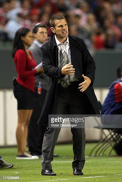 Assistant Coach Greg Vanney of Chivas USA shouts instructions to players on the field in the second half during their MLS match against FC Dallas at...