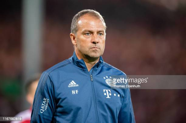 Assistant coach Hansi Flick of Muenchen reacts prior the DFB Cup first round match between Energie Cottbus and FC Bayern Muenchen at Stadion der...
