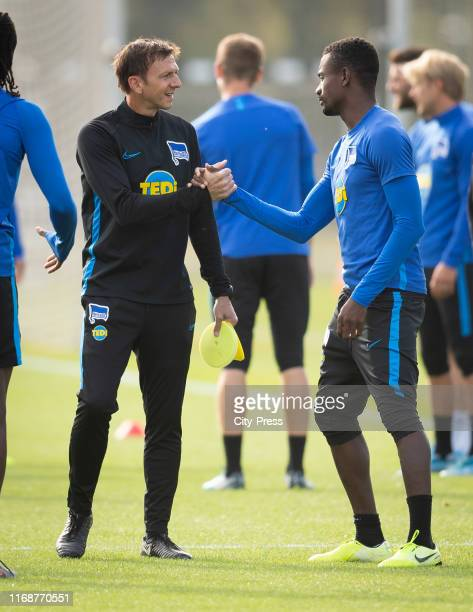 Assistant coach Harald Gaemperle and Salomon Kalou of Hertha BSC klatschen ab before the Training on september 17, 2019 in Berlin, Germany.