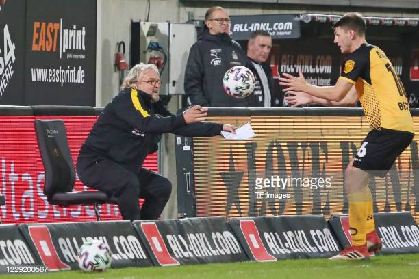assistant coach Heiko Scholz of SG Dynamo Dresden and Robin Becker of SG Dynamo Dresden gestures during the 3 Liga match between Dynamo Dresden and...