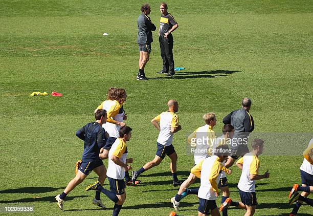Assistant coach Henk Duut and head coach Pim Verbeek look on during an Australian Socceroos trainin session at Ruimsig Stadium on June 14 2010 in...