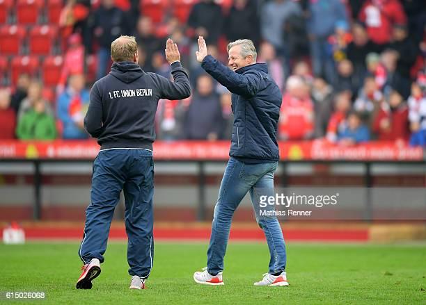 assistant coach Henrik Pedersen and coach Jens Keller of 1 FC Union Berlin celebrate the 21 win during the Second Bundesliga match between 1 FC Union...