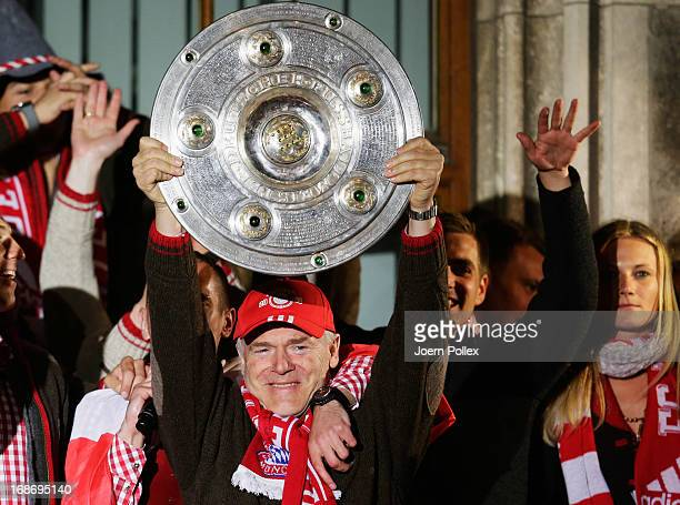 Assistant coach Hermann Gerland of Bayern Muenchen celebrates with team mates the German championship title on the town hall balcony at Marienplatz...