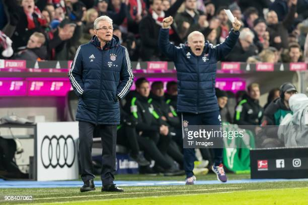 Assistant coach Hermann Gerland of Muenchen and Head coach Jupp Heynckes of Muenchen celebrate after Robert Lewandowski of Muenchen scored his team`s...