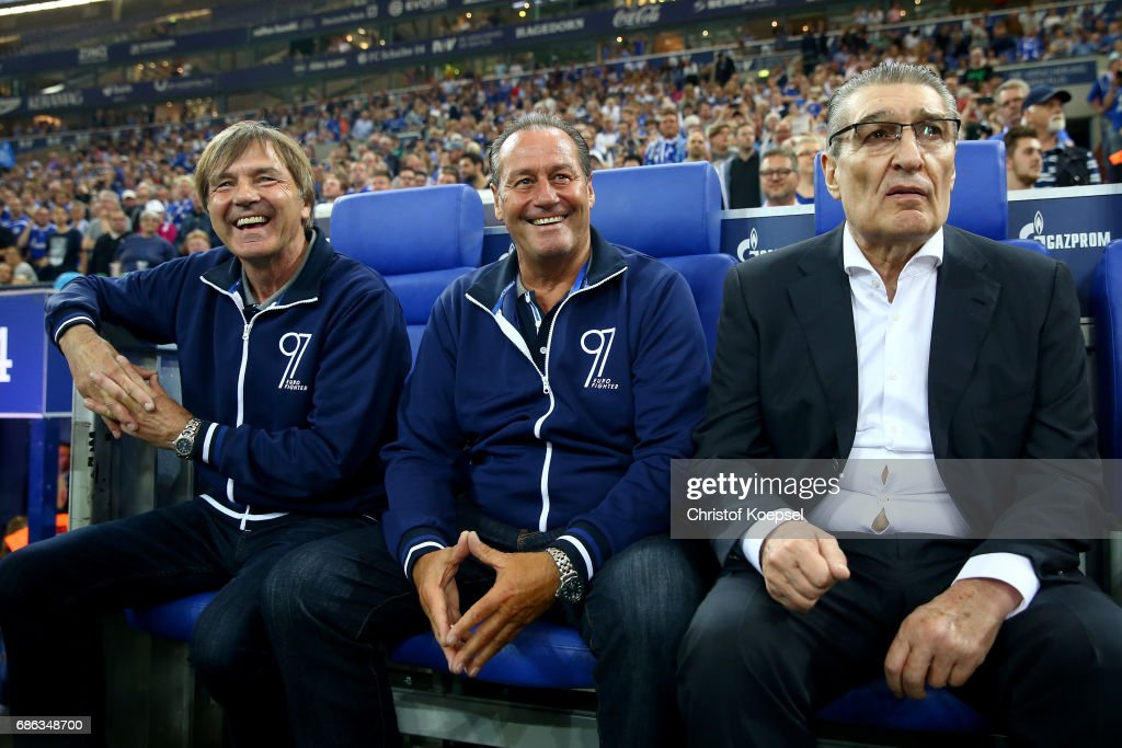 Assistant coach Hubert Neu, head coach Huub Stevens and former manager Rudi Assauer are seen during the 20 years of Eurofighter match between Eurofighter and Friends and Euro All Stars at Veltins Arena on May 21, 2017 in Gelsenkirchen, Germany.