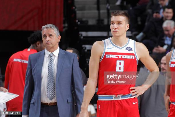 Assistant Coach Igor Kokoskov and Bogdan Bogdanovic of the Sacramento Kings look on during the game against the Denver Nuggets on November 30, 2019...
