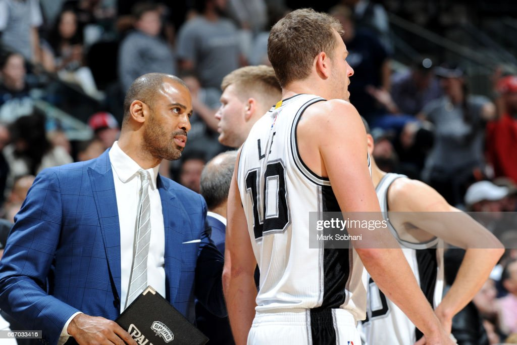 Assistant coach Ime Udoka of the San Antonio Spurs talks with David Lee #10 of the San Antonio Spurs during the game against the Atlanta Hawks on March 13, 2017 at the AT&T Center in San Antonio, Texas.