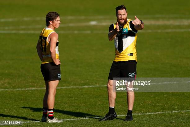 Assistant coach Jake Batchelor gives feedback to Leo Connolly of the Saints during a St Kilda Saints AFL training session at RSEA Park on June 03,...