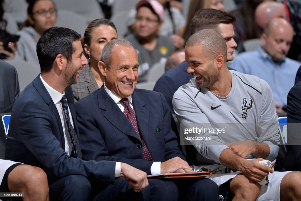 Assistant Coach James Borrego of the San Antonio Spurs, Assistant Coach Ettore Messina of the San Antonio Spurs, and Tony Parker #9 of the San Antonio Spurs react during the game against the Orlando Magic on March 13, 2018 at the AT&T Center in San Antonio, Texas.