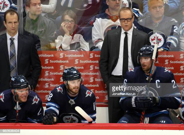 Assistant Coach Jamie Kompon and Head Coach Paul Maurice of the Winnipeg Jets look on during third period action against the Chicago Blackhawks at...