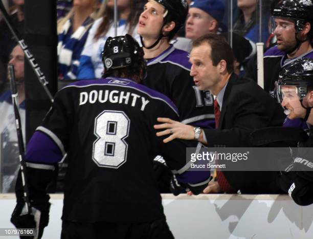 Assistant coach Jamie Kompon gives last minute instructions to Drew Doughty of the Los Angeles Kings in their game against the Toronto Maple Leafs at...