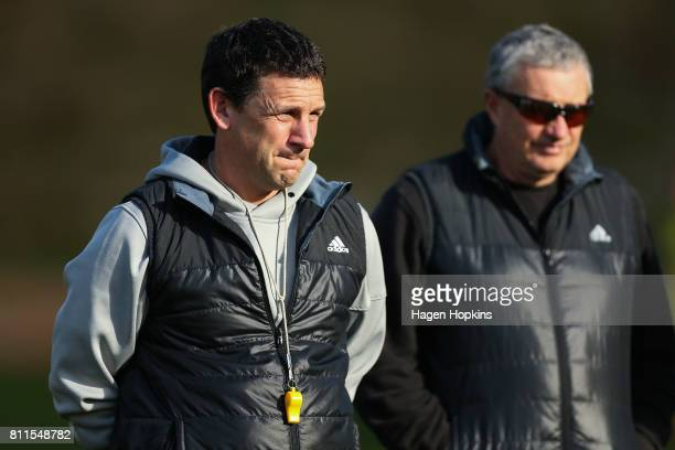 Assistant coach Jason Holland and coach Chris Boyd look on during a Hurricanes Super Rugby training session at Rugby League Park on July 10 2017 in...