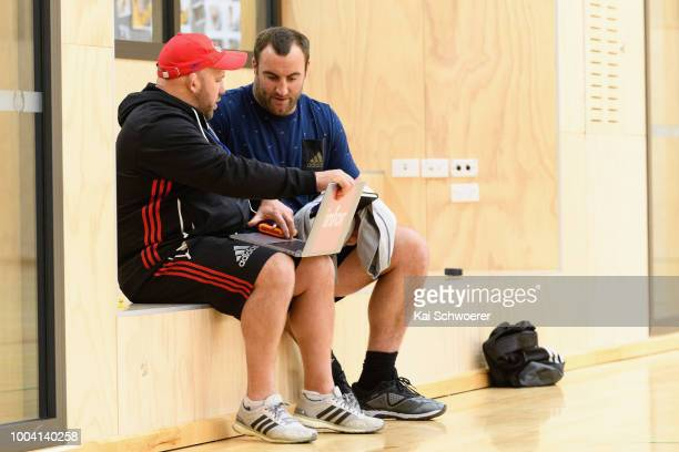 Assistant Coach Jason Ryan and Tim Perry look on during a Crusaders Super Rugby training session at St Andrew's College on July 23 2018 in...