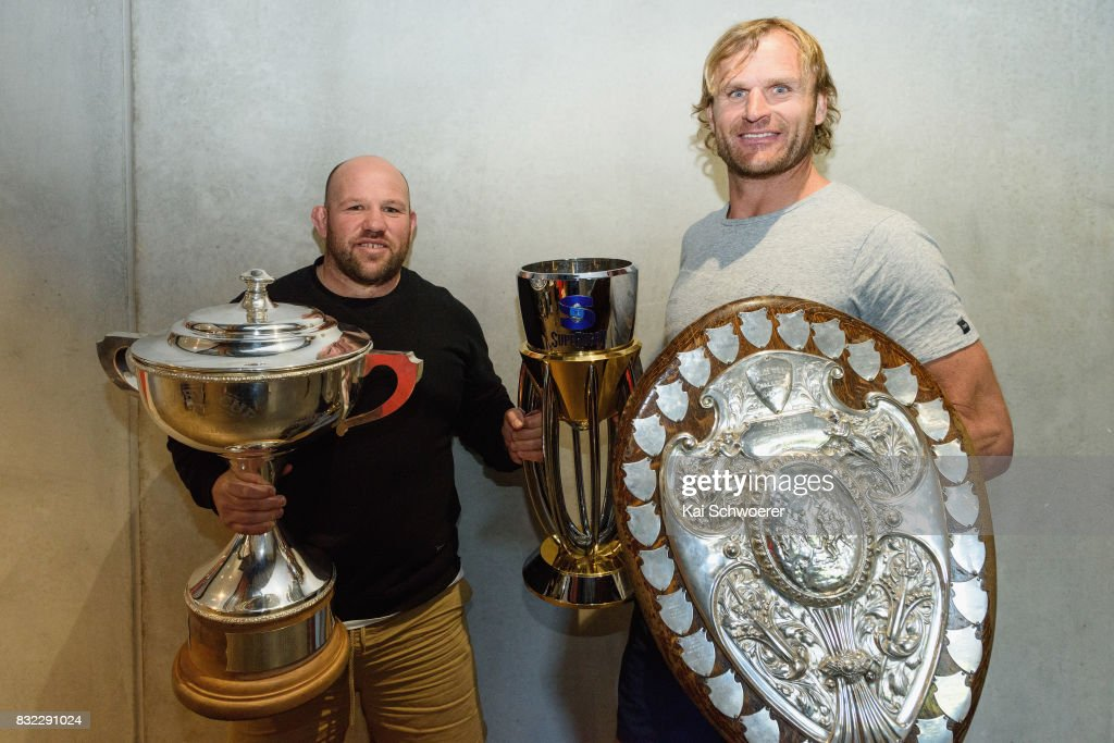 Assistant Coach Jason Ryan of the Crusaders and Head Coach Scott Robertson of the Crusaders (L-R) pose with the Rugby Cup, the Super Rugby Trophy and the Ranfurly Shield (L-R) following a Canterbury Rugby training session at Rugby Park on August 16, 2017 in Christchurch, New Zealand.