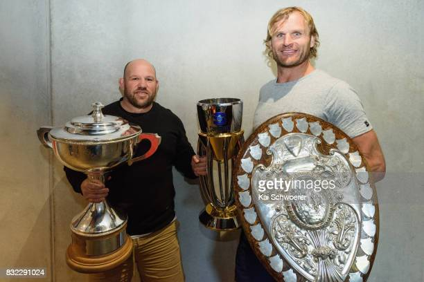 Assistant Coach Jason Ryan of the Crusaders and Head Coach Scott Robertson of the Crusaders pose with the Rugby Cup the Super Rugby Trophy and the...