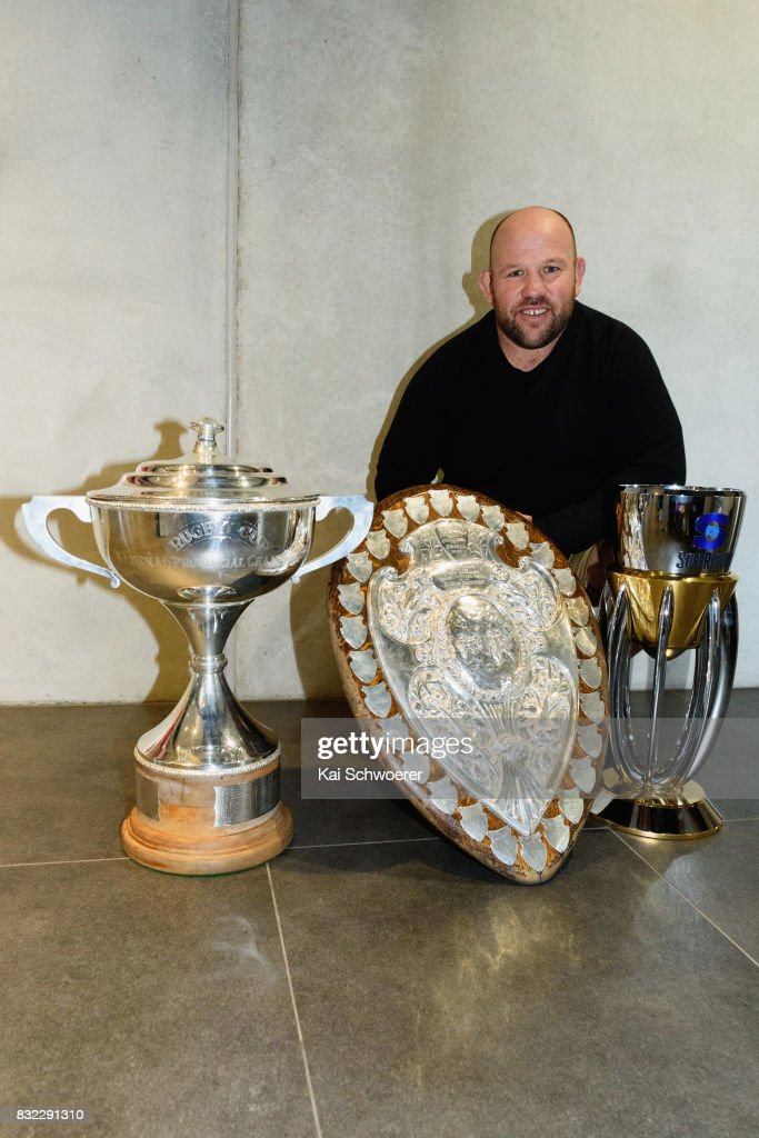 Assistant Coach Jason Ryan of the Crusaders poses with the Rugby Cup, the Ranfurly Shield and the Super Rugby Trophy (L-R) following a Canterbury Rugby training session at Rugby Park on August 16, 2017 in Christchurch, New Zealand.