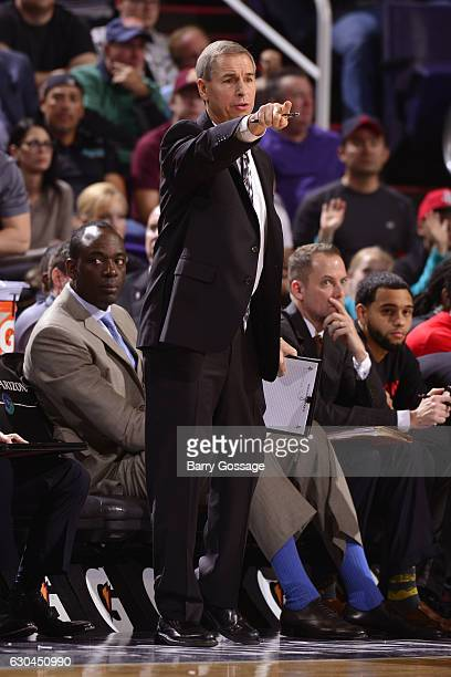 Assistant Coach Jeff Bzdelik of the Houston Rockets reacts to a play against the Phoenix Suns on December 21 2016 at Talking Stick Resort Arena in...