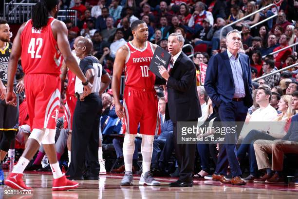 Assistant Coach Jeff Bzdelik of the Houston Rockets speaks with Eric Gordon and Nene Hilario of the Houston Rockets during the game against the...