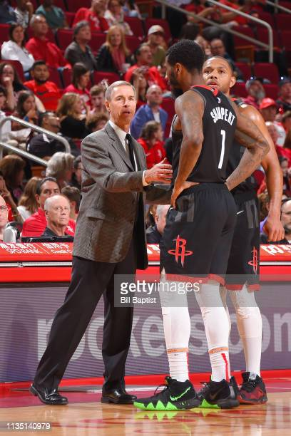 Assistant Coach Jeff Bzdelik speaks with Iman Shumpert of the Houston Rockets during the game against the New York Knicks on April 5 2019 at the...