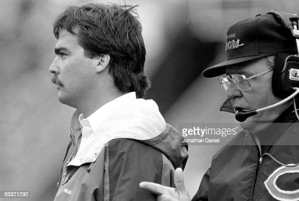 Assistant coach Jeff Fisher and defensive coordinator Buddy Ryan of the Chicago Bears look on during the game against the Green Bay Packers at...