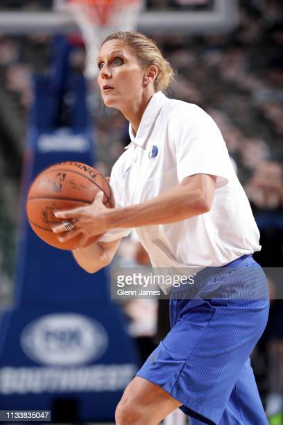 Assistant Coach Jenny Boucek of the Dallas Mavericks warms up players before the game against the Sacramento Kings on March 26 2019 at the American...