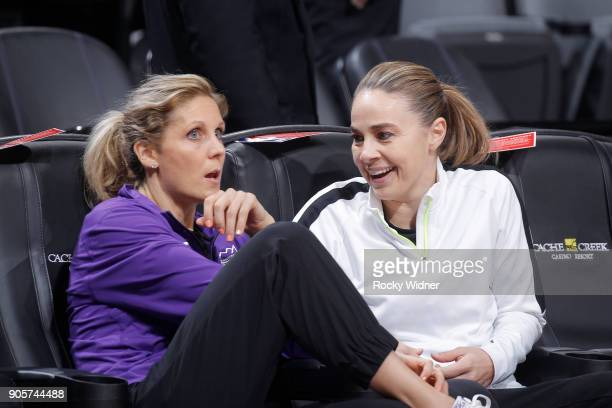 Assistant coach Jenny Boucek of the Sacramento Kings talks with assistant coach Becky Hammon of the San Antonio Spurs prior to the game on January 8...