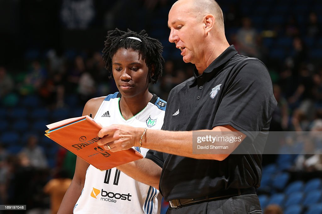 Assistant Coach Jim Peterson directs Amber Harris #11 of the Minnesota Lynx during the WNBA pre-season game against the Connecticut Sun on May 21, 2013 at Target Center in Minneapolis, Minnesota.