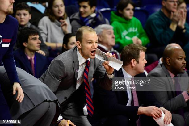 Assistant coach Joe Mihalich Jr of the Pennsylvania Quakers yells to his team against the Yale Bulldogs during the first half at The Palestra on...