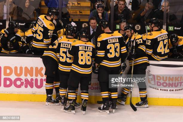 Assistant Coach Joe Sacco of the Boston Bruins talks to his team during the third period against the Tampa Bay Lightning at the TD Garden on November...