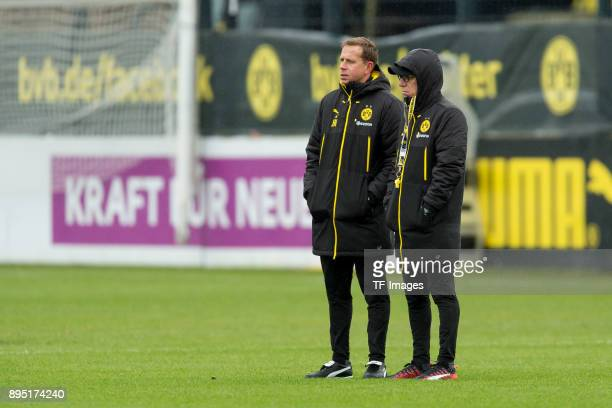 Assistant coach Joerg Heinrich of Dortmund and Head coach Peter Stoeger of Dortmund look on during a training session at BVB trainings center on...