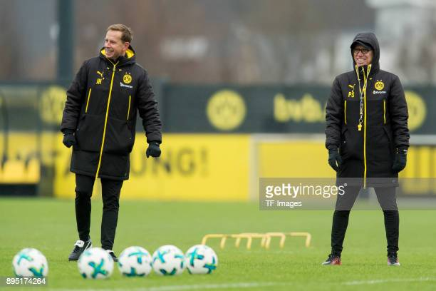 Assistant coach Joerg Heinrich of Dortmund and Head coach Peter Stoeger of Dortmund laugh during a training session at BVB trainings center on...
