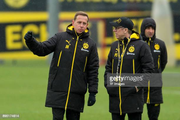 Assistant coach Joerg Heinrich of Dortmund speaks with Head coach Peter Stoeger of Dortmund during a training session at BVB trainings center on...