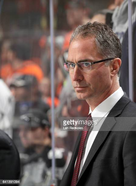 Assistant Coach John Stevens of the Los Angeles Kings watches warmups from the bench prior to his game against the Philadelphia Flyers on February 4...